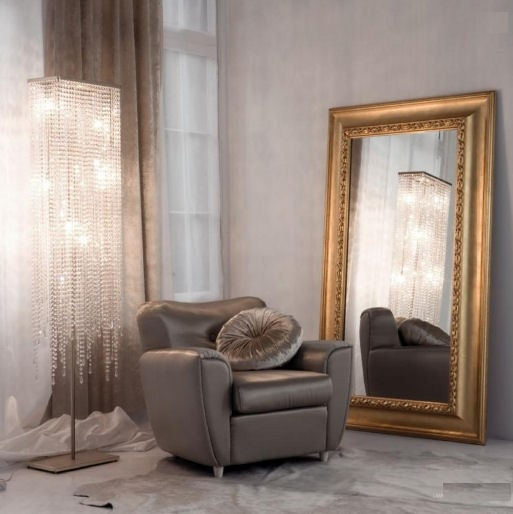 thick golden frame leaning mirror